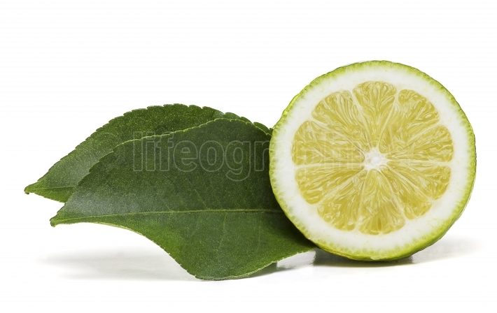 Half lemon fruit with two leaves on the side