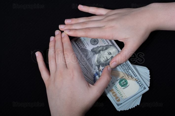 Hand holding American dollar  isolated on white background