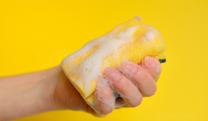 Hand with sponge with foam