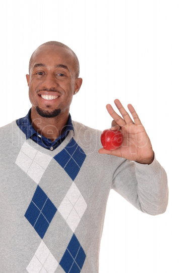 Handsome African man holding up a red apple