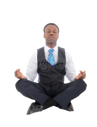 Handsome African man sitting doing yoga