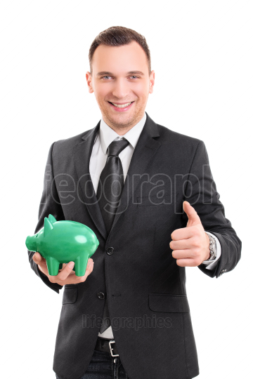 Handsome businessman with a piggy bank giving thumb up