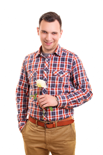 Handsome stylish young man holding a flower