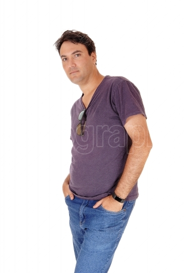 Handsome tall young man standing hands in pocket