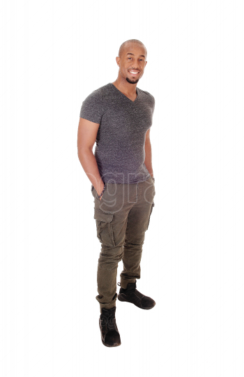 Happy African Man standing with his hands in his pocket