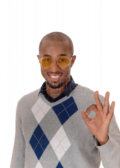 Happy African man with glasses saying is OK
