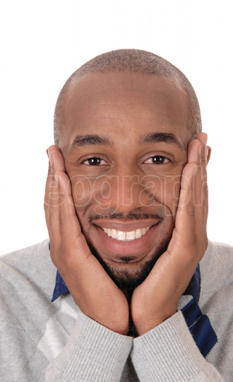 Happy African man with hands on his face