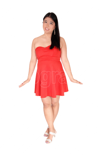 Happy Asian woman in a red short dress smiling