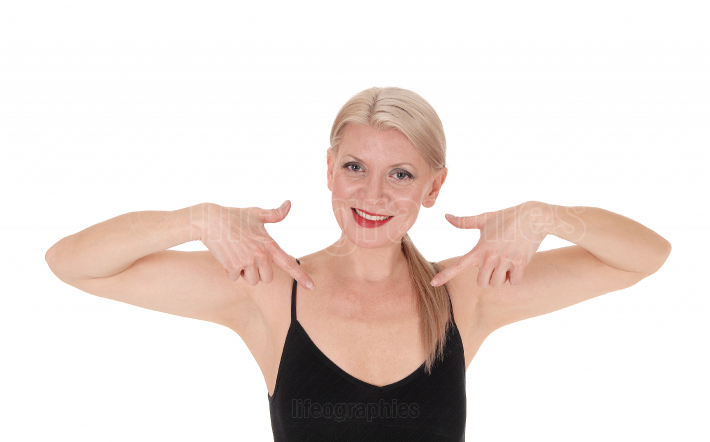 Happy blond woman pointing at herself