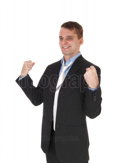 Happy business man standing with fists lifted up