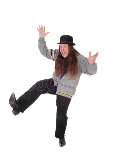 Happy jumping middle age man with long hair and hat