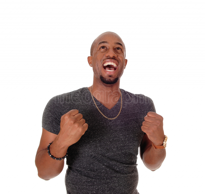 Happy laughing African American man with mouth open