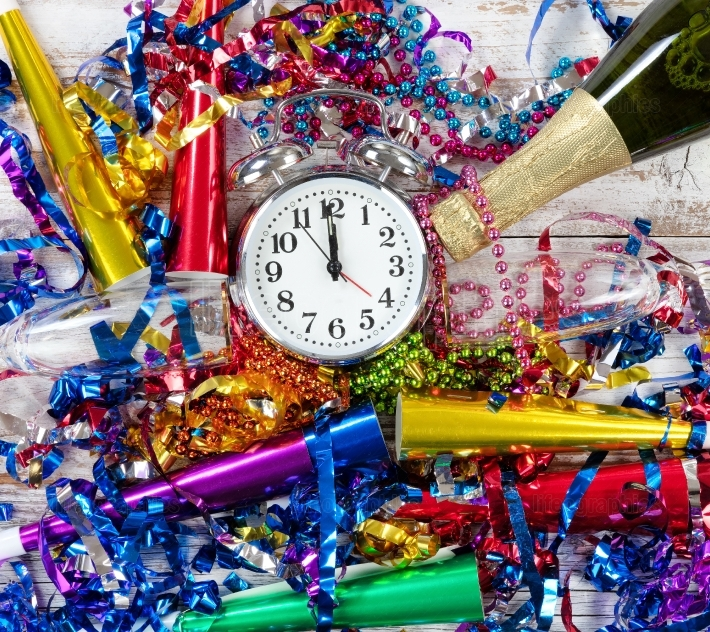 Happy New Year Celebration with clock in center of party objects