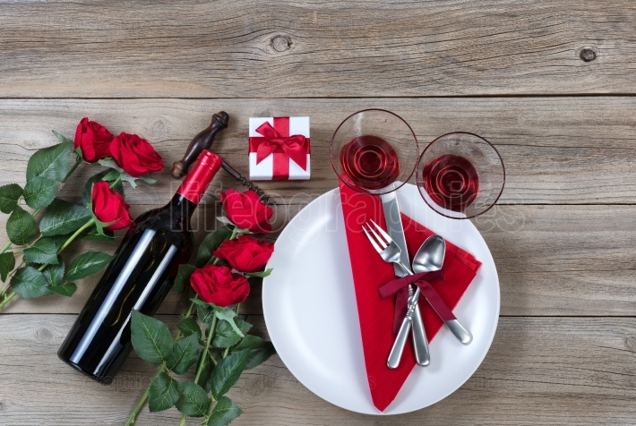 Happy Valentine Dinner Setting on rustic wooden background