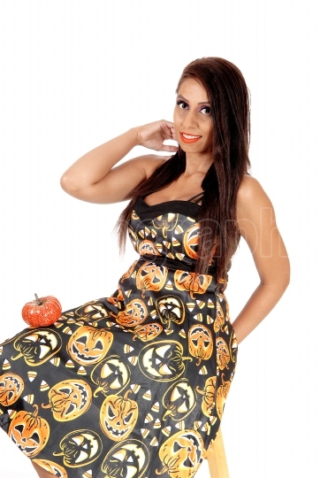 Happy woman siting in Halloween dress