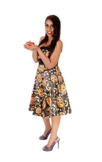 Happy woman standing in a Halloween dress