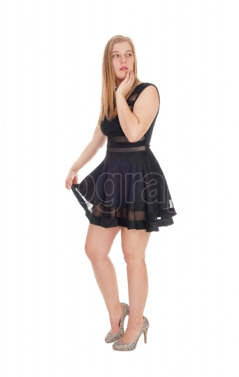 Happy woman standing in a short black dress