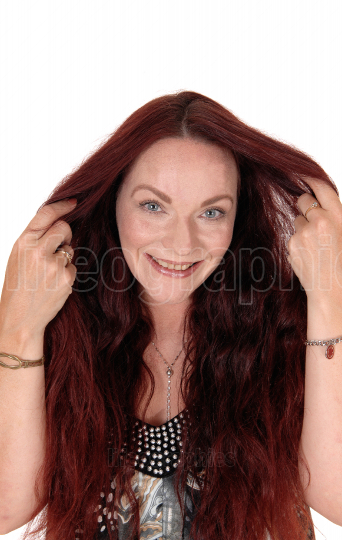 Happy woman with her long red hair