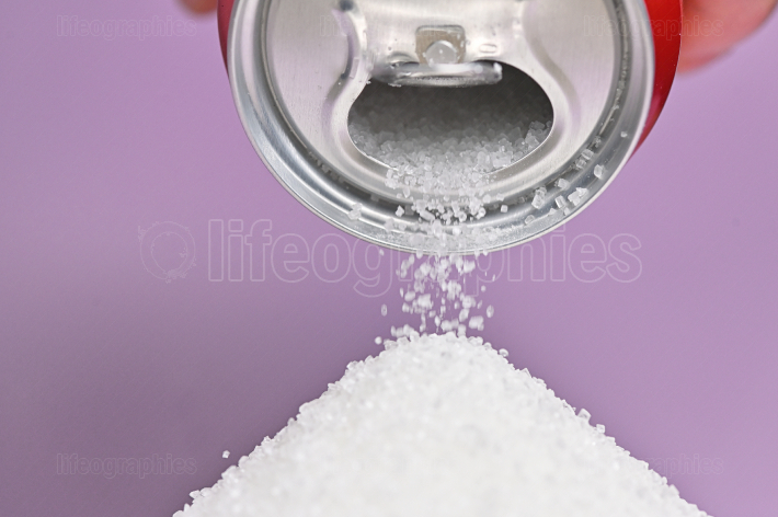 Holding A Soda Can Pouring Sugar