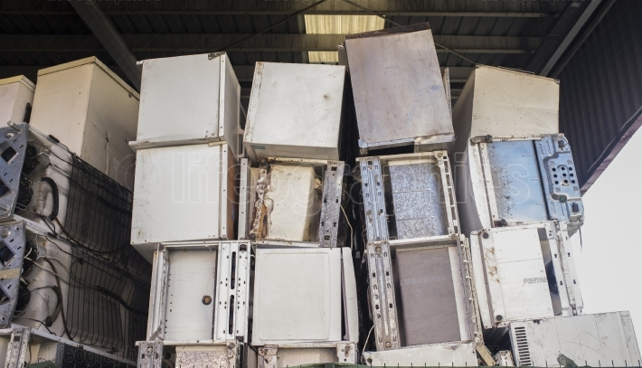 Huge piles of refrigerators stacked at recycling plant