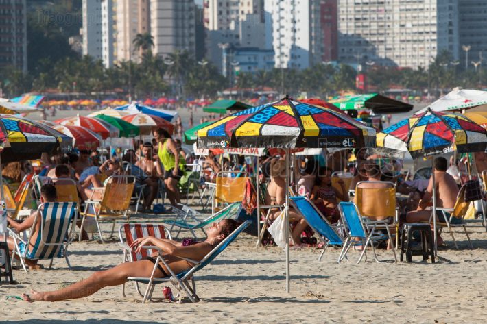 Hundreds Of Brazilians Enjoy Sunny Day At Sao Vicente Beach