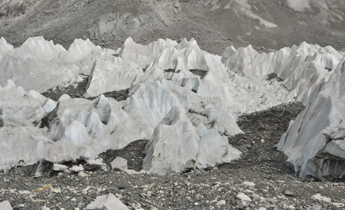 Ice formations and stones layers from deep valley of Khumbu Glacier from Everest Base Camp, Himalaya. Nepal Himalaya. Nepal.