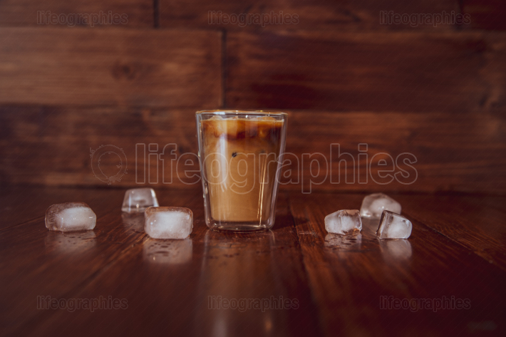 Iced coffee with ice on table