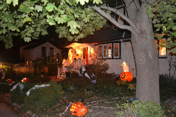 Image of a house in the night with Halloween decoration