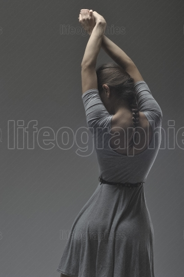 Image of inspired girl dancing in studio
