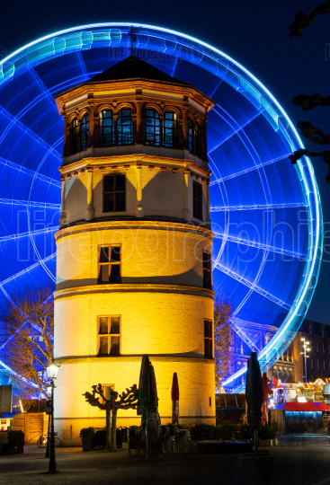 In motion, illuminated giant wheel