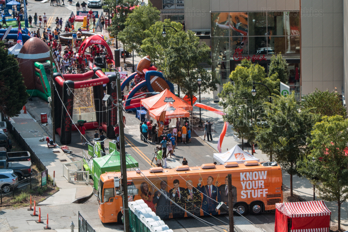 Inflatable Games Set Up Along Street At College Football Festival