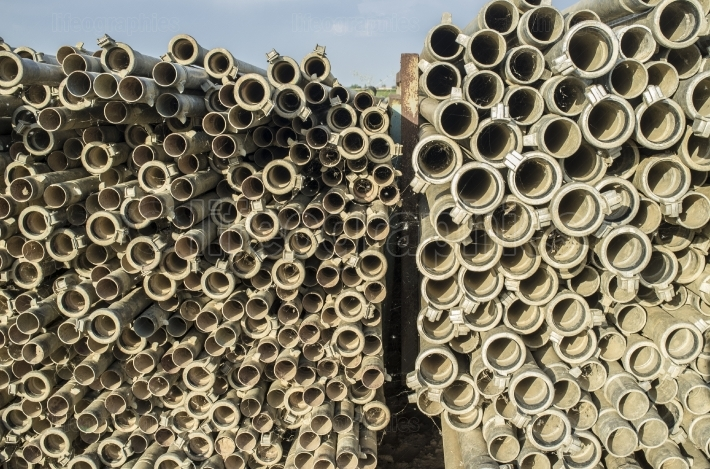 Irrigation metal pipes stacked outdoors out of watering season