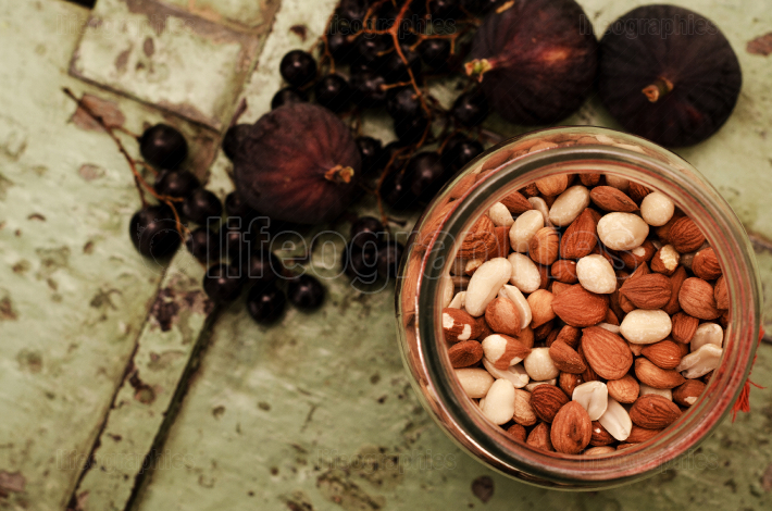 Jar of seeds with figs in the background