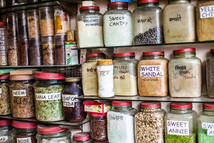 Jars of herbs and powders in a indian spice shop