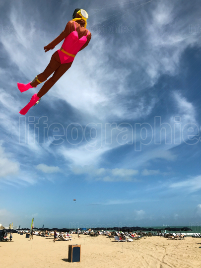 Kite Shaped Like Female Scuba Diver Flies Above Florida Beach