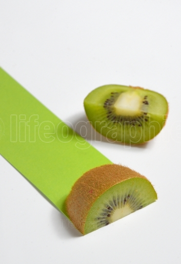 Kiwi fruit sliced and green path