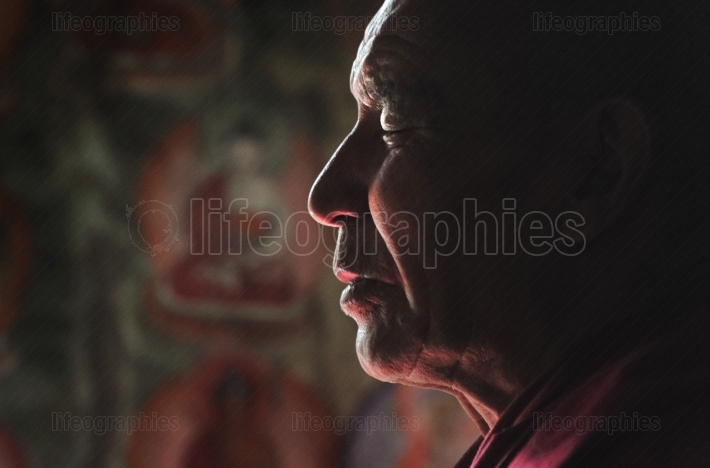Ladakhi lama meditating with closed eyes