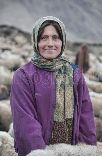 Lady from upper shimshal in the middle of sheeps