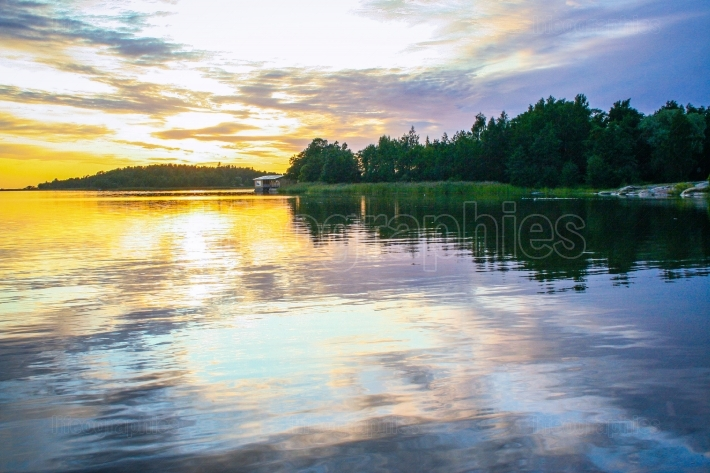 Lakescape at sunset   in Finland