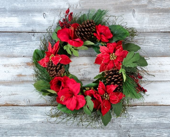 Large Traditional Christmas wreath on white vintage wooden plank