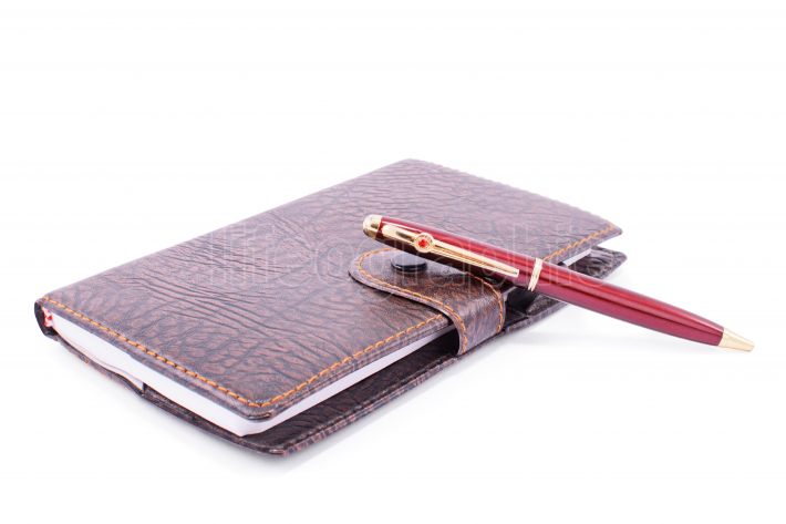 Leather planner notebook with a pen