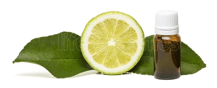 Lemon essential oil with two side leaves
