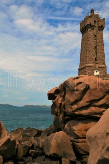 Lighthouse  at Ploumanach, on the  pink granite coast, Brittany, France