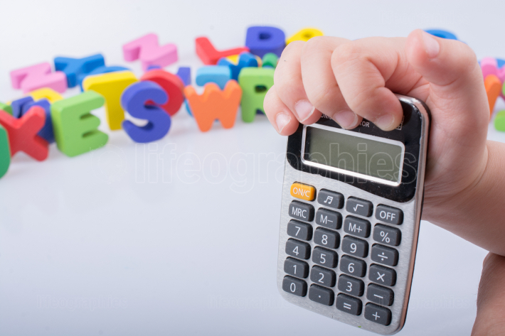 Little calculator in hand with colorful letters behind