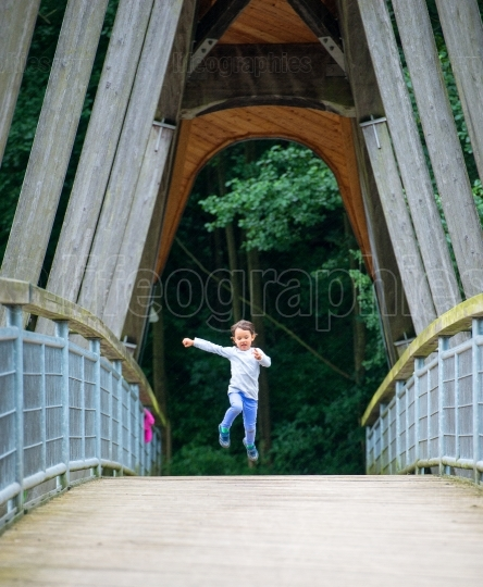 Little child having fun by running and jumping