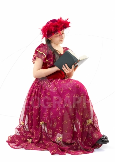 Little girl in retro clothes reading book