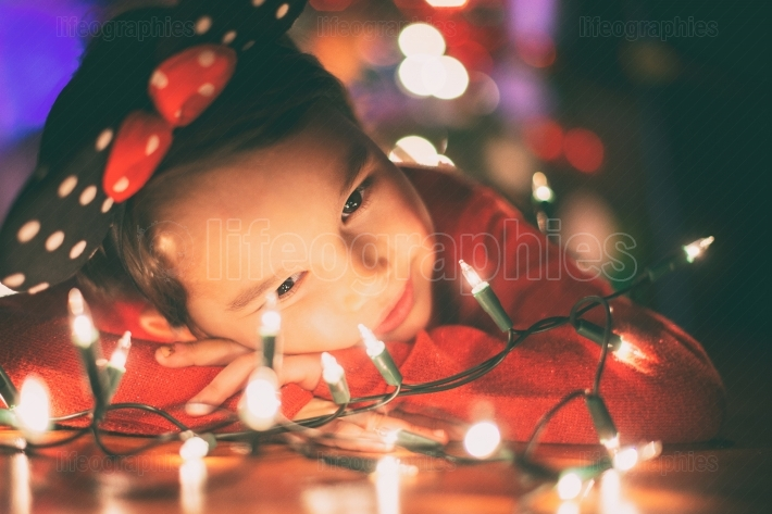 Little girl with christmas lights