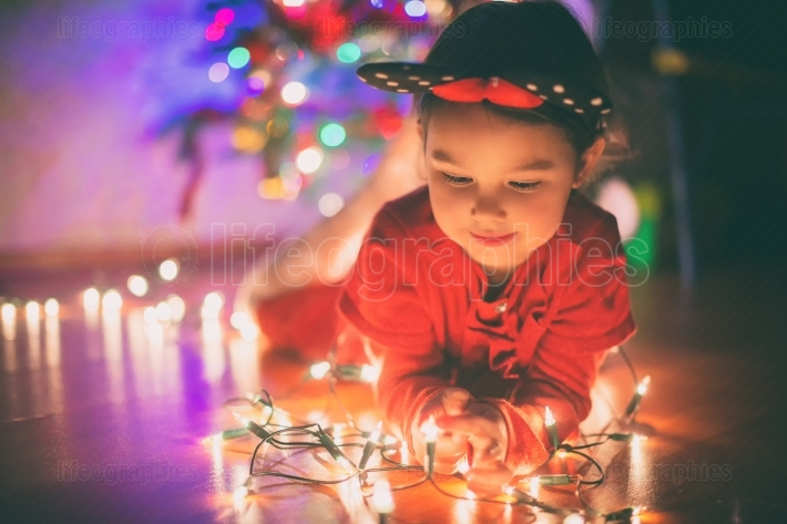 Little girl withs christmas lights