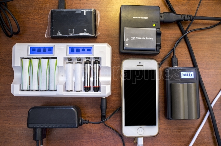 Lots of charger devices as mobile, rechargable batteries, camera