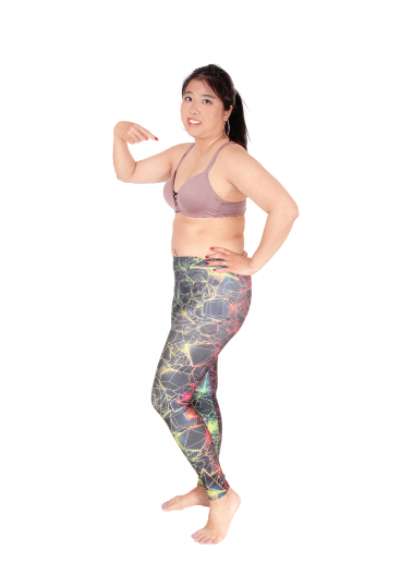 Lovely Asian woman standing in sports bra and leggings